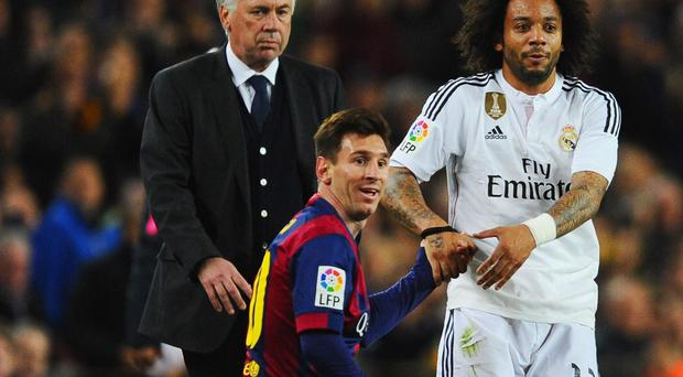 Carlo Ancelotti keeps an eye on Lionel Messi during an El Clasico clash