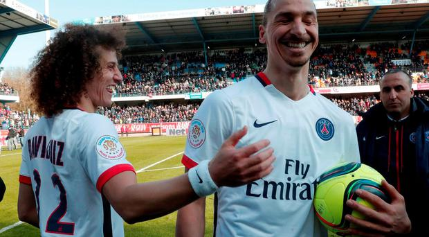 Paris St Germain players Zlatan Ibrahimovic (R) and David Liuiz celebrate their French Ligue 1 title after winning against Troyes. REUTERS/Philippe Wojazer