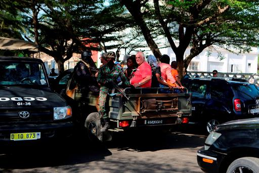 Security forces evacuate people in Bassam, Ivory Coast, March 13, 2016. REUTERS/Joe Penney
