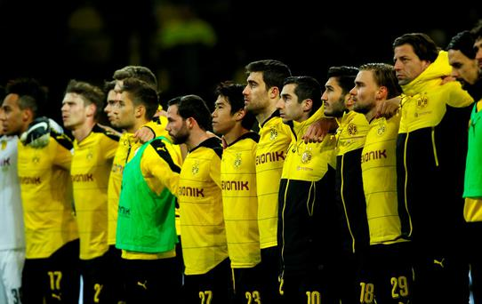 The team of Borussia Dortmund commemorates a supporter, who died during the match in the stadium