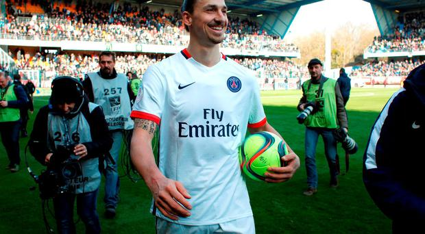 PSG's Zlatan Ibrahimovic smiles after PSG won the French league title, during their League One soccer match against Troyes