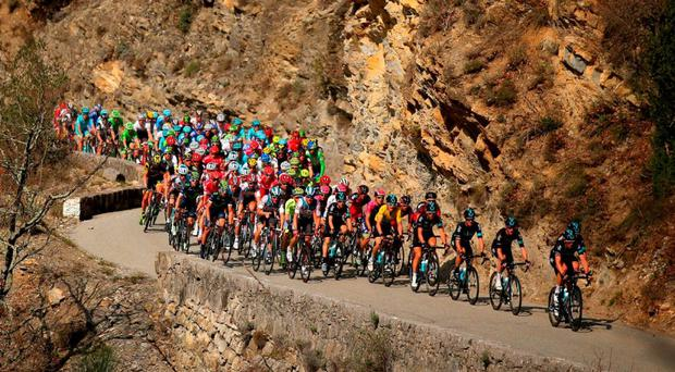 Team Sky riders lead the yellow jersey of Geraint Thomas during the final stage of Paris-Nice yesterday. Photo: Bryn Lennon/Getty Images