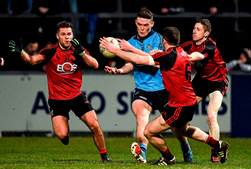 Dublin's Brian Fenton is closed down by the Down trio Gerald Collins, Aidan Carr and Joe Murphy at Pairc Esler on Saturday night Photo: Oliver McVeigh / SPORTSFILE