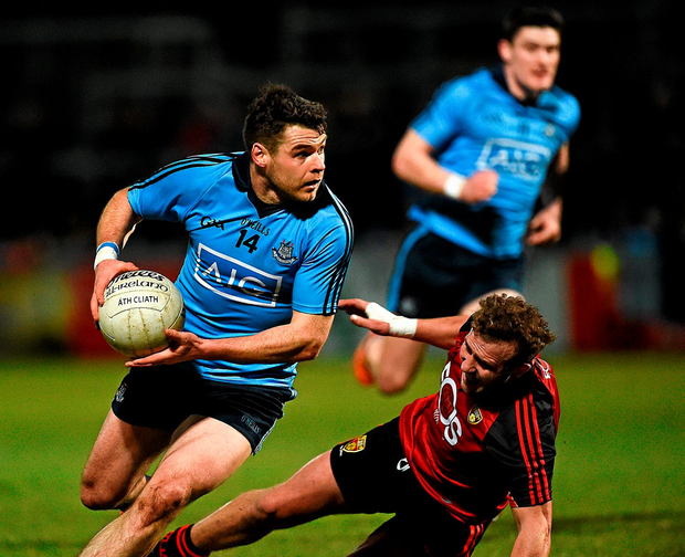 Kevin McManamon, Dublin, in action against Darren O'Hagan, Down Photo: Oliver McVeigh / SPORTSFILE