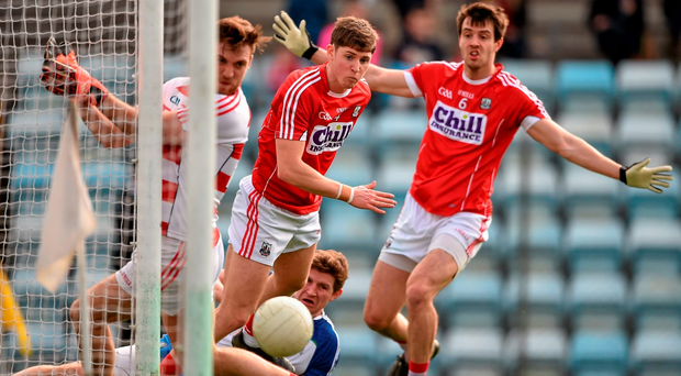 Cork players (l-r) Ryan Price, Kevin Crowley, and Jamie O'Sullivan watch a shot by Darren Hughes go narrowly wide Photo: Brendan Moran / SPORTSFILE