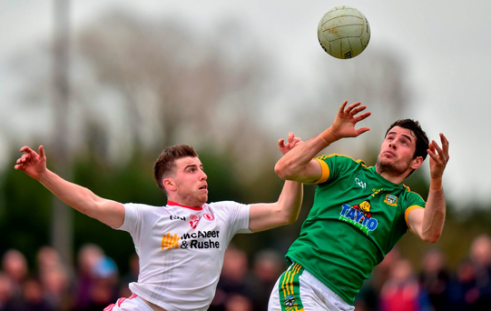Meath's Donal Keoghan leaps for a high ball against Tyrone's Connor McAliskey in their Allianz NFL match in Navan Photo: Ramsey Cardy / SPORTSFILE