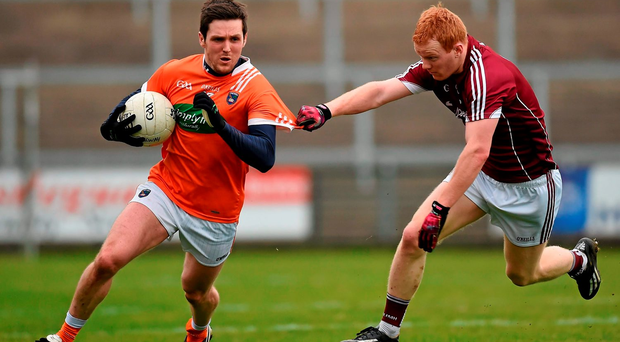 Colm Watters, Armagh, in action against Declan Kyne, Galway Photo: Philip Fitzpatrick / SPORTSFILE