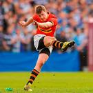 CBC's James Taylor kicks the point for his side to clinch the Munster Schools Senior Cup. Photo: Eóin Noonan / Sportsfile