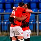 London Welsh's Josh Drauniniu celebrates with team-mate Matt Corker at the final whistle. Photo: Cody Glenn / Sportsfile