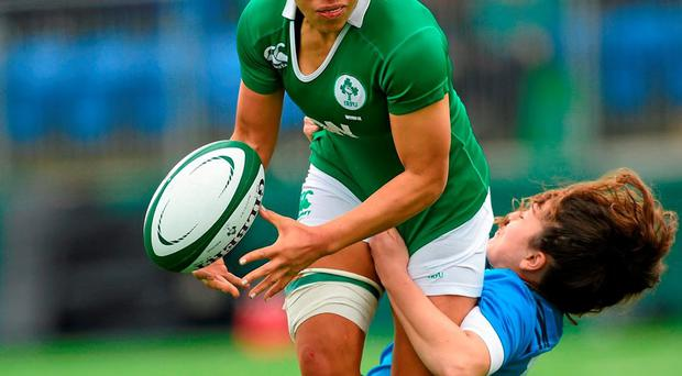 Ireland's Sene Naouou is tackled by Italy's Maria Grazia Cioffi in Donnybrook yesterday. Photo: Paul Mohan / Sportsfile