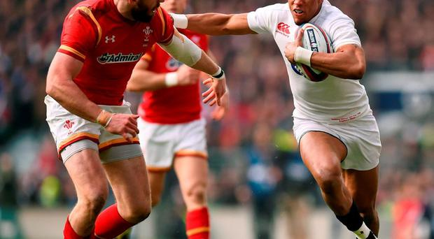 England's Anthony Watson hands off Wales' Alex Cuthbert. Photo: Stu Forster/Getty Images