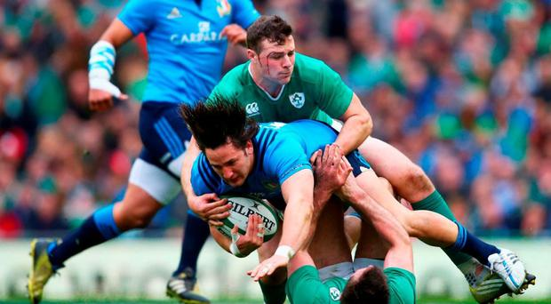 Robbie Henshaw, one of five Connacht players on the pitch on Saturday, combines with Jared Payne to tackle Italy's Michele Campagnaro at the Aviva Stadium. Photo: Michael Steele/Getty Images
