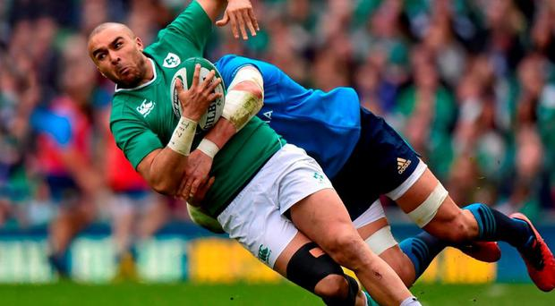 Ireland's Simon Zebo is tackled by Italy's Sergio Parisse during Saturday's Six Nations clash at the Aviva Stadium. Photo: Ramsey Cardy / Sportsfile