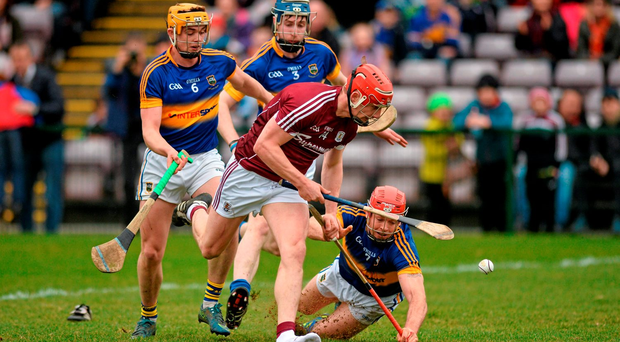 Galway's Joe Canning skips through the Tipperary defence despite losing his boot Photo: Ray Ryan / SPORTSFILE