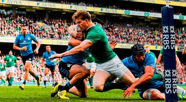 Andrew Trimble powers his way over to score the first of Ireland's nine tries against Italy on Saturday. Photo: Ramsey Cardy / Sportsfile