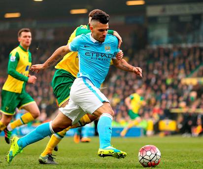 Norwich City's Gary O'Neil and Manchester City's Sergio Aguero battle for the ball. Photo: Chris Radburn/PA Wire