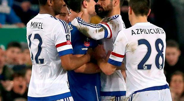 Chelsea's Diego Costa and Everton's Gareth Barry getting involved in a altercation. Photo: Martin Rickett/PA Wire.