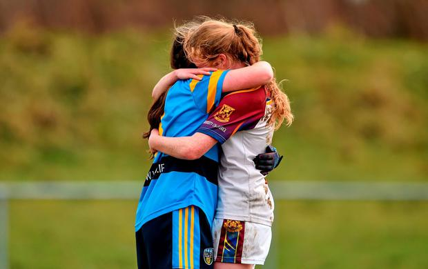 Louise Ward (right) congratulates her victorious twin sister Nicola after UCD's O'Connor Cup triumph Photo: Sportsfile