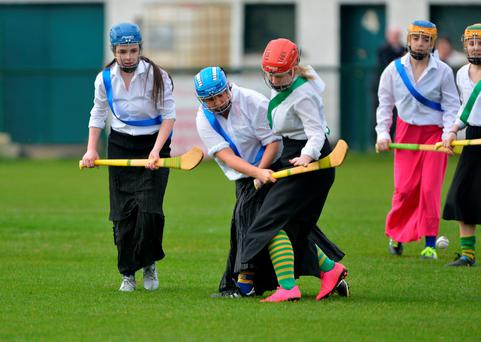 Camogie teams from St Finbarr's and Blackrock GAA clubs in Cork played an exhibition match in 1916 gear yesterday to commemorate a similar game 100 years ago. Photo: Provision