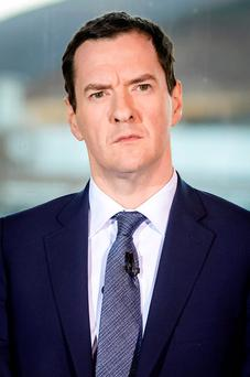 George Osborne faces an £18bn hole in Britain's public finances as the UK economy is now projected to be smaller than first forecast in November's Autumn Statement Photo: PA