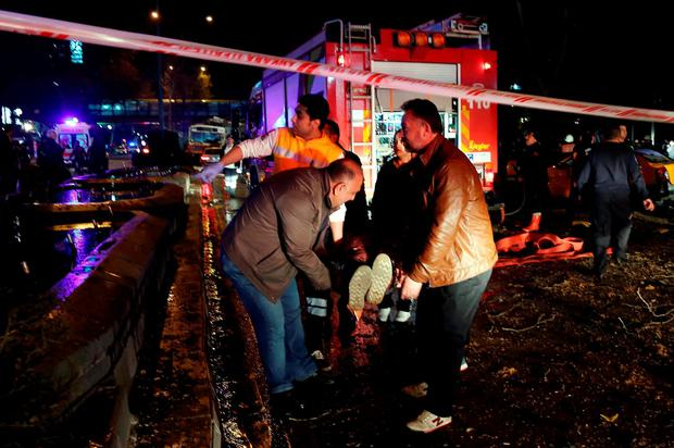 An injured person is carried at the explosion site in the busy center of Turkish capital, Ankara, Turkey, Sunday, March 13, 2016