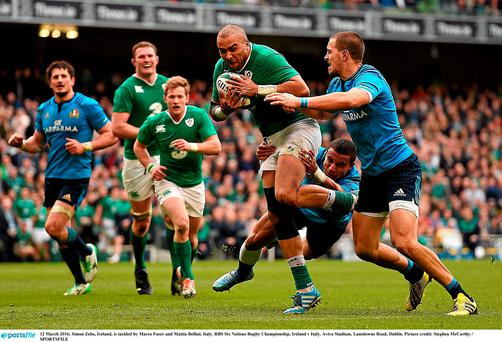 Simon Zebo, Ireland, is tackled by Marco Fuser and Mattia Bellini, Italy