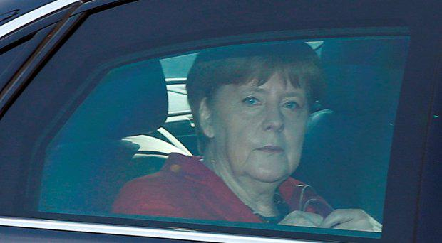 German Chancellor and leader of the Christian Democratic Union (CDU) Angela Merkel sits in her limousine as she arrives to a party's meeting in Berlin, Germany, March 14, 2016