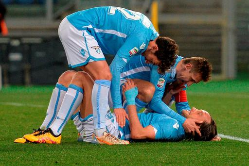 Lazio's German forward Miroslav Klose (C) celebrates with his teammates Mauri (down) and and Cataldi after scoring during the Italian Serie A football match between Lazio and Atalanta at Rome's Olympic Stadium on March 13, 2016. / AFP PHOTO / ANDREAS SOLAROANDREAS SOLARO/AFP/Getty Images