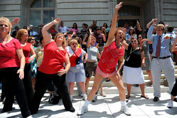 Fitness advocate Richard Simmons, wearing his signature shorts and tanktop, leads Capitol Hill staff and visitors through an exercise routine July 24, 2004 in Washington, DC