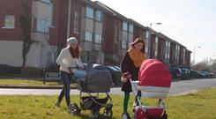 Two young mothers who have received notices to quit take their babies for a stroll at the Cruise Park housing estate in Tyrellstown in West Dublin. Photo: RollingNews