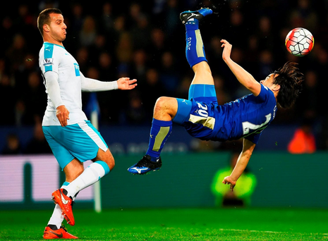 LEICESTER, ENGLAND - MARCH 14: Shinji Okazaki of Leicester City scores their first goal with an overhead kick as Steven Taylor of Newcastle United looks on during the Barclays Premier League match between Leicester City and Newcastle United at The King Power Stadium on March 14, 2016 in Leicester, England. (Photo by Laurence Griffiths/Getty Images)
