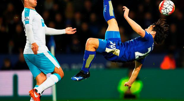 Leicester's Shinji Okazaki puts them in front with an overhead kick during their clash against Newcastle. LAURENCE GRIFFITHS/GETTY IMAGES