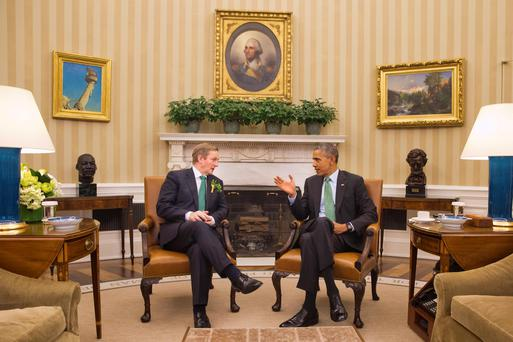 Taoiseach Enda Kenny speaking to US President Barack Obama in the Oval Office of the White House last year. (AP Photo/Jacquelyn Martin)