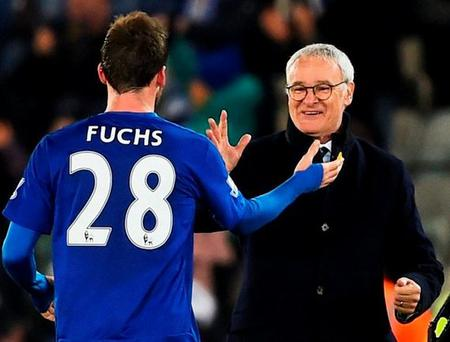 Christian Fuchs (28) and Claudio Ranieri celebrate beating Newcastle United at The King Power Stadium. Photo by Laurence Griffiths/Getty Images