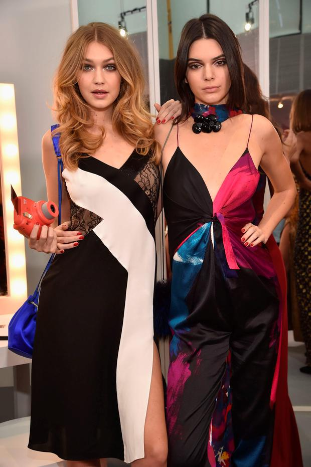 Models Gigi Hadid (L) and Kendall Jenner pose wearing Diane Von Furstenberg Fall 2016 during New York Fashion Week on February 14, 2016 in New York City. (Photo by Dimitrios Kambouris/Getty Images)