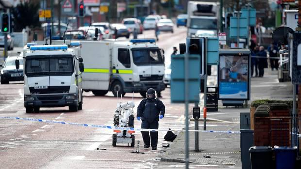 A bomb disposal unit officer at the scene following a suspected car bomb attack on a prison officer at Hillsborough Drive on March 4, 2016 in Belfast, Northern Ireland. (Photo by Charles McQuillan/Getty Images)