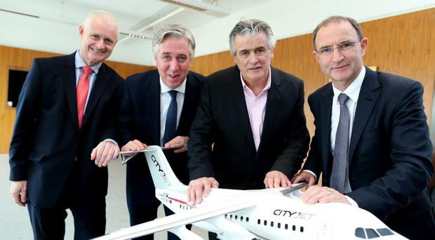 Cathal O' Connell, CityJet; John Delaney, FAI; Pat Byrne, CityJet and Irish team manager, Martin O' Neill.