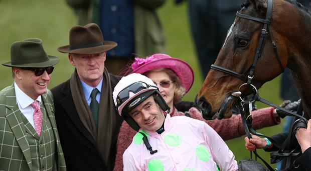 CHELTENHAM, ENGLAND - MARCH 15: Ruby Walsh celebrates in the winners' enclosure with trainer Willie Mullins and owner Rich Ricci after riding Douvan to victory in the Racing Post Arkle Challenge Trophy Chase on day one, Champion Day, of the Cheltenham Festival at Cheltenham Racecourse on March 15, 2016 in Cheltenham, England. (Photo by Michael Steele/Getty Images)