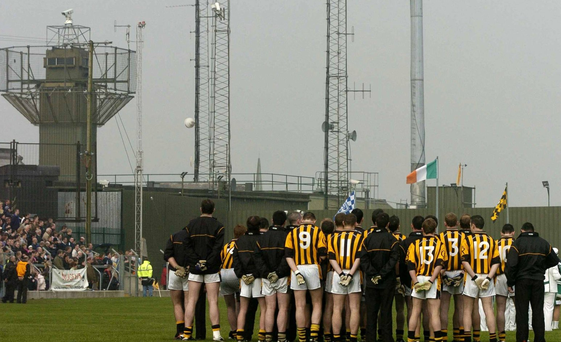The Crossmaglen team stand for the national anthem with the old British Army base in the background back in 2005. Photo: David Maher/Sportsfile
