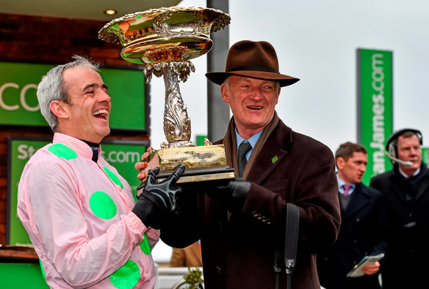Ruby Walsh and Willie Mullins are all smiles as they lift the Champion Hurdle trophy – in stark contrast to the emotions the rider felt last year when Annie Power fell at the final flight (below) in the OLBG Mares Hurdle (SPORTSFILE)