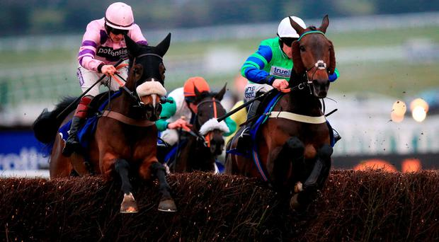 Ballyalton (right), with Brian Hughes up, jumps the final fence alongside Bouvreuil on the way to winning the concluding Close Brothers Novices' Handicap Chase at Cheltenham (Mike Egerton/PA)