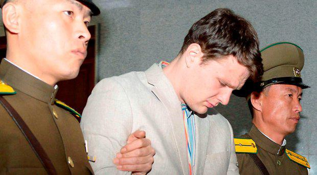 Otto Frederick Warmbier (C), a University of Virginia student who was detained in North Korea since early January, is taken out of North Korea's top court after being sentenced, in Pyongyang, North Korea, in this photo released by Kyodo March 16, 2016