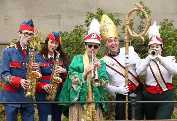 St. Patrick, pictured with Gavin Hodson (left) and Aisling Williams from the Artane Band along with John an Lynsay Kearns from the Clondalkin Marching Band as the Saint arrived in Dublin, climbing the steps of the capital's iconic Mansion House. Pic. Robbie Reynolds.