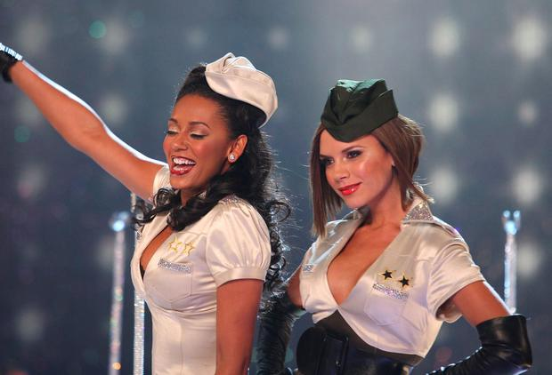Singers Mel B and Victoria Beckham of the Spice Girls onstage at the 12th Victoria's Secret Fashion show at the Kodak Theater on November 15, 2007 in Hollywood, California. (Photo by John Shearer/WireImage)