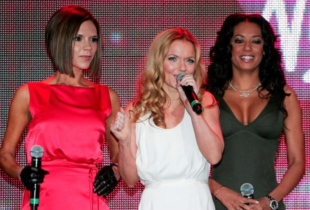 Spice Girls Victoria Beckham, (L) Geri Halliwell (C) and Mel B, launch the opening of a new Virgin Atlantic terminal at Heathrow Airport, in west London, 13 December 2007