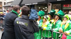 An Irish TV crew filming at the New York St Patrick's Day parade. This year's parade will be broadcast live for the first time by Irish TV from 3-7pm (GMT) on March 17 on Sky 191, Freesat 400, eVision 191, all free-to-air boxes and online atwww.irishtv.com.