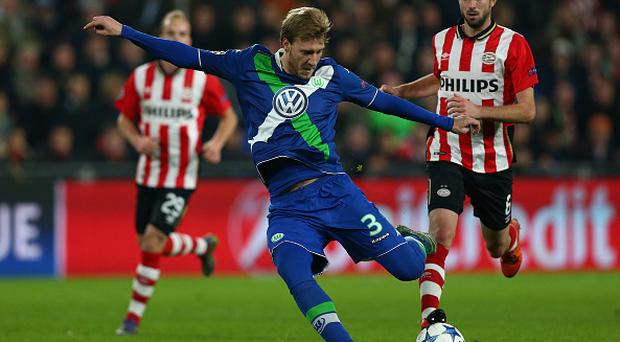 EINDHOVEN, NETHERLANDS - NOVEMBER 03: Nicklas Bendtner of VfL Wolfsburg takes a shot at goal during the UEFA Champions League match between PSV Eindhoven and VfL Wolfsburg at the Philips Stadion on November 3, 2015 in Eindhoven, Netherlands. (Photo by Harry Engels - UEFA/UEFA via Getty Images)