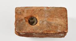 Portion of a brick in which is embedded a bullet, fired by the firing party which executed Mr Francis Sheehy Skeffington at Portobello Barracks, that passed through the body of the late Francis Sheehy Skeffington. With authenticating letter signed by F. McL. Scannell, December 1935 (NMI Archives). HE:EW.683