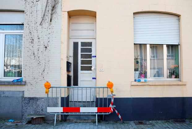The front door of an apartment is pictured in the Brussels district of Forest where a gunman was shot dead by Belgian police on Tuesday after a raid on the apartment linked to investigations into November's Islamist attacks in Paris March 16, 2016