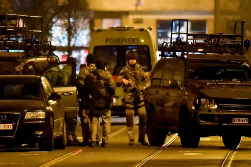 Special operations police take positions during a raid in Brussels